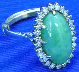 Cabochon Jade and Diamond Ring.