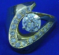 Contemporary 14kt Gold and Diamond Ring.