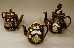 Three Measham Bargeware Teapots and a Trivet