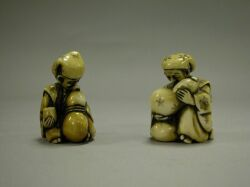 Two Japanese Carved Ivory Nodder Netsuke.