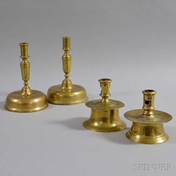 Four Early Continental Brass Candlesticks