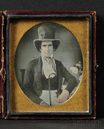 Sixth Plate Daguerreotype Portrait of a Seated Young Man Wearing a Top Hat