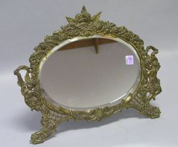 Oval Victorian Cast Brass Angels Decorated Table Mirror with Beveled Glass.