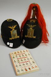 Two 19th Century New York State National Guard Helmets and a British Uniforms Book.