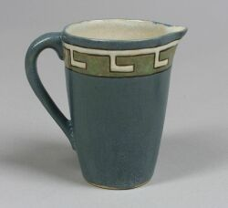 Saturday Evening Girls Pottery Pitcher