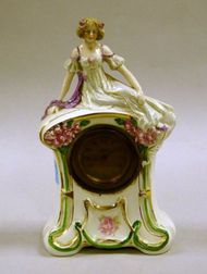 Figural Ceramic Mantel Clock.