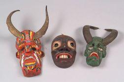 Three Polychrome Carved Wood Masks