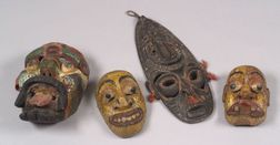 Four Polychrome Carved Wood Masks