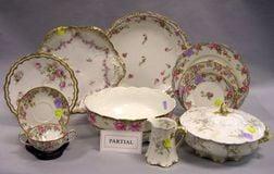Assembled Seventy-six Piece Limoges Floral Transfer Decorated Porcelain Partial Dinner Service.