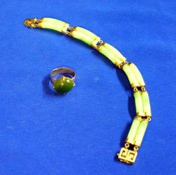 Gumps 14kt Gold and Jade Bracelet and a 16kt Gold and Spinach Jade Ring.
