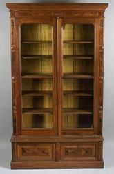 Pair of Renaissance Revival Walnut Library Bookcases