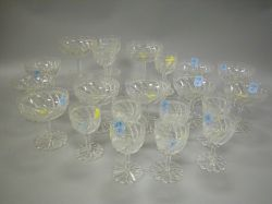 Set of Twenty-one Colorless Cut Glass Champagne and Wine Stems.