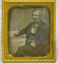 Daguerreotype Portrait of a Seated Gentleman with Quill Pen.