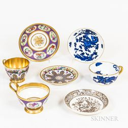 Three Porcelain Cups and Four Saucers