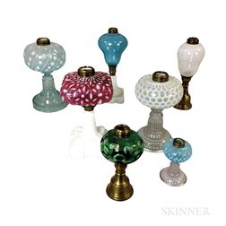 Seven Mostly Pressed Glass Fluid Lamps