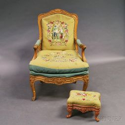 Louis XV-style Carved Fruitwood Fauteuil and a Cast Iron Footstool