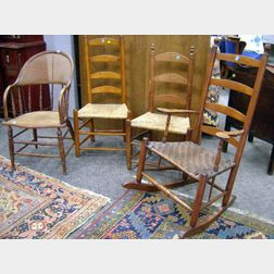 Slat-back Armrocker, Two Side Chairs, and a Caned Ash Sack-back Armchair.