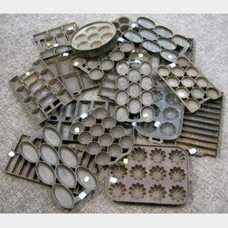 Eighteen Assorted Cast Iron Baking Pans
