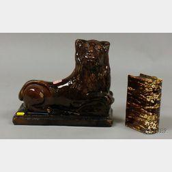 Rockingham Glazed Pottery Recumbent Lion Figure and a Bennington Pottery Flint   Enamel Glazed Book-form Flask