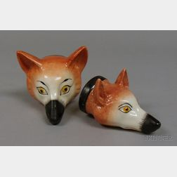 Two Staffordshire Fox Stirrup Cups.