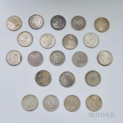 Seventeen Morgan Dollars and Four Peace Dollars.     Estimate $400-600