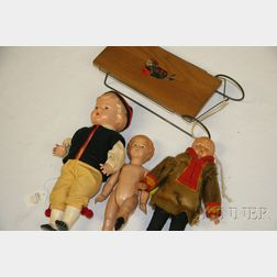 Three Celluloid Dolls and a Sled