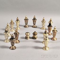 Sixteen Assorted Sterling Weighted Salt and Pepper Shakers.     Estimate $100-150