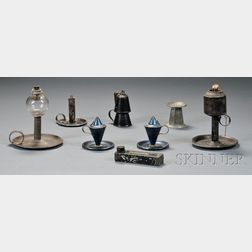 Seven Early Tin Lighting Devices and a Tin Sander