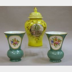 Pair of German Hand-painted Floral Decorated Porcelain Mantel Vases and a Vienna-style Decorated Covered Porcelain Jar.