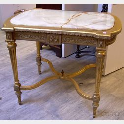 Louis XVI Style Onyx-inset Metal-mounted Giltwood Center Table.