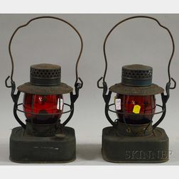"""Pair of Painted Tin and Red Glass """"City of Marlboro 8-Day"""" Kerosene Lamps"""