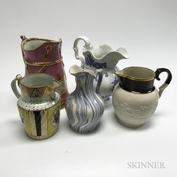 Ten Staffordshire Ceramic Pitchers