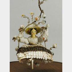 Swinging Grodnertal Shell Doll