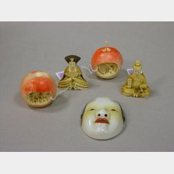 Japanese Carved Ivory Emperor and Empress Figures, a Small Porcelain Mask, and a Pair of Chinese Carved Ivory Apples with Interior Land