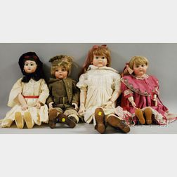 Group of Four Large Reproduction Bisque Head Dolls