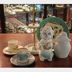 Bisque Figurals, a Majolica Dish, Two Wedgwood Demitasse Cups and Saucers, and a Gilt-metal Mounted Porcelain Knife Stand.