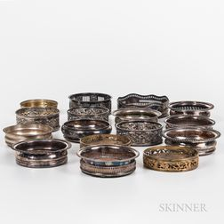 Sixteen Silver-plate and Brass Wine Coasters
