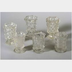 Six Colorless Pressed Glass Spoon Holders