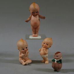 Four Bisque Kewpie and Kewpie-type Figurines