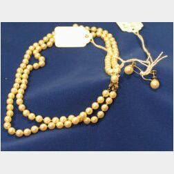 Strand of Cultured Pearls and a Pair of Gold and Pearl Earrings.