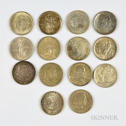 Fourteen Commemorative Half Dollars