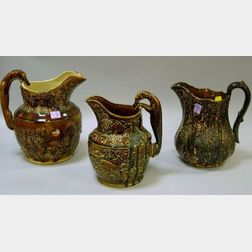 Three Bennington-type Glazed Stoneware Pitchers.