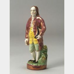 Polychrome Enamel and Pink Lustre Staffordshire Pottery Figure of Benjamin Franklin