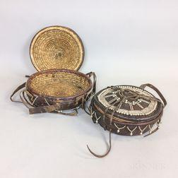 Two Modern Ethiopian Beaded Hide Lidded Baskets.     Estimate $200-300
