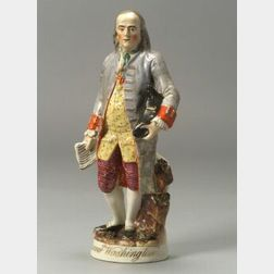 Polychrome Enamel Decorated Staffordshire Pottery Figure of Benjamin Franklin