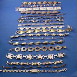 Eighteen Sterling Silver Link Bracelets