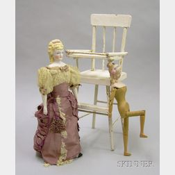 Two Dolls and Two Pieces of Play Furniture