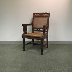 Renaissance Revival Caned and Carved Oak Armchair