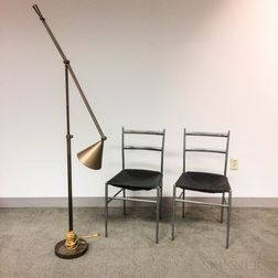 Pair of Aluminum and Leather Side Chairs and Contemporary Metal Floor Lamp.     Estimate $100-200