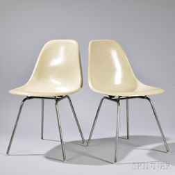 Two Shell Chairs by Charles and Ray Eames, manufactured by Herman Miller, Zeeland, Michigan, molded fiberglass and tubular steel, ivory